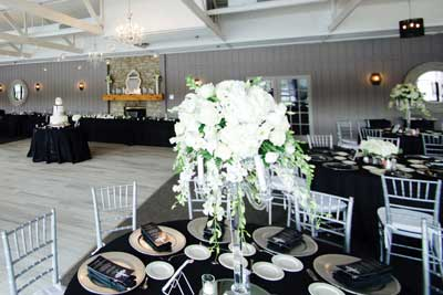 The Lodge at The Willows decorated for a black and white wedding reception in Indianapolis