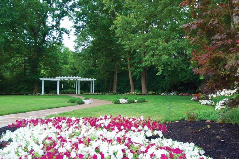 The Lakefront Garden at The Willows features beautiful landscaping and a manicured lawn for an outdoor wedding in Indianapolis