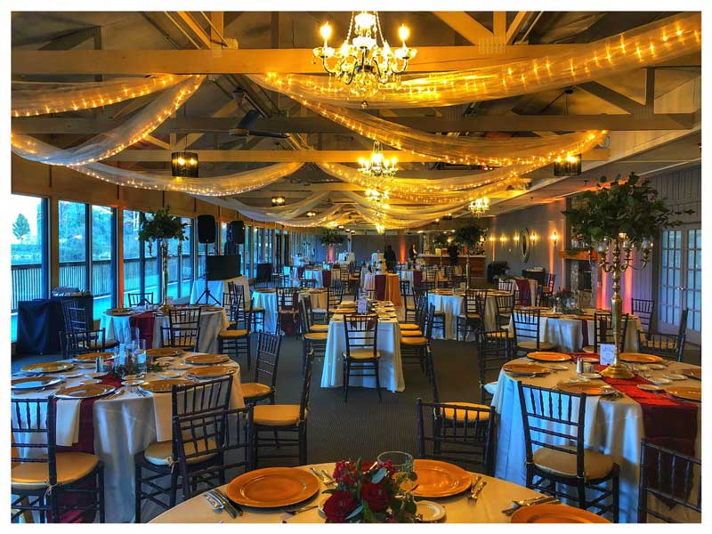 The Lodge at The Willows set up for an elegant wedding reception in a lakefront venue