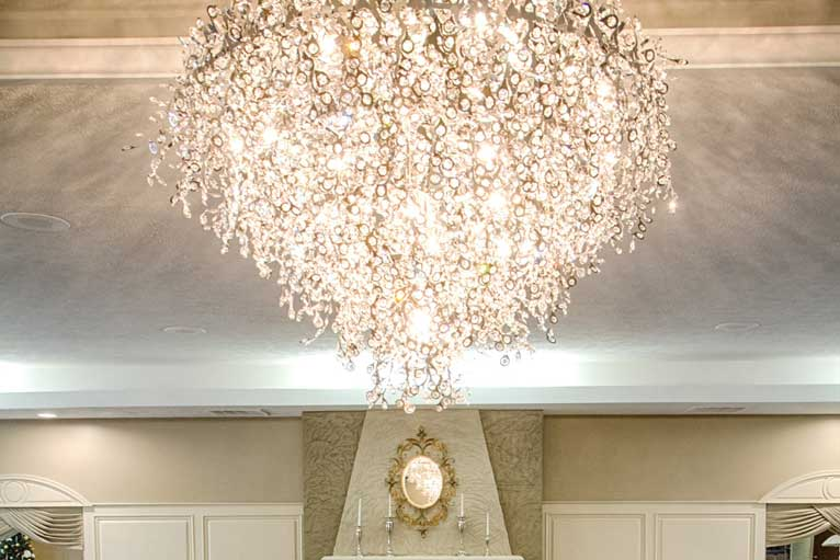 The Ballroom at The Willows features a stunning chandelier that is perfect for any formal event
