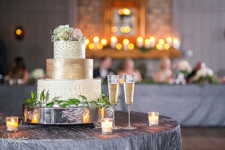 Garden-themed wedding cake at a reception at The Lodge at The Willows in Indianapolis