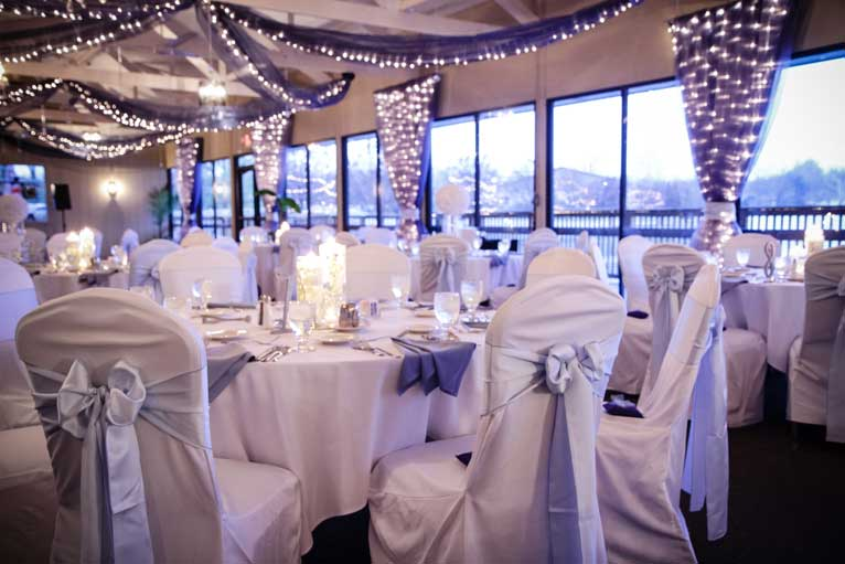 The Lodge at The Willows decorated with candles and string lights give this wedding reception a rustic feeling