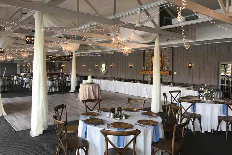 White and blue decorated wedding reception at The Lodge at The Willows