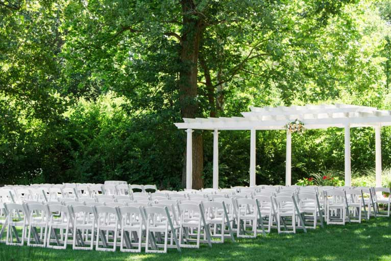 Theatre seating for an outdoor wedding ceremony at The Lakefront Gardens at The Willows in Broad Ripple