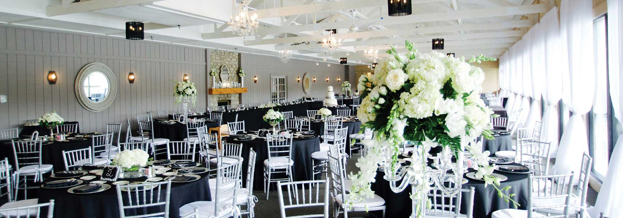 The Lodge at The Willows decorated in white for a formal wedding reception