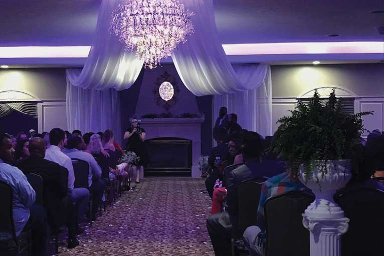 Guests gather at a wedding ceremony at The Ballroom at The Willows in Indianapolis