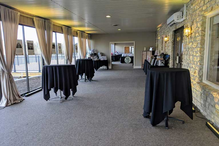 The terrace at The Ballroom at The Willows hosts silent auction items for a charity event