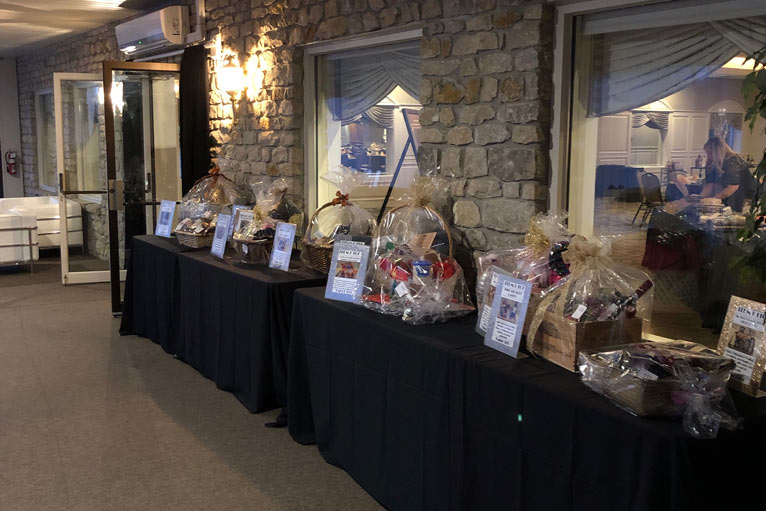 Fundraising items laid out on the terrace at The Ballroom at The Willows in Indianapolis