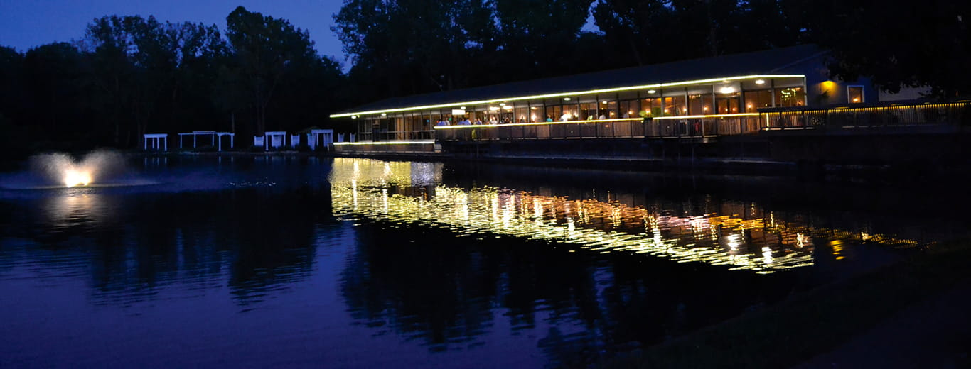 The Lodge at The Willows at night, a lakefront event venue in Indianapolis