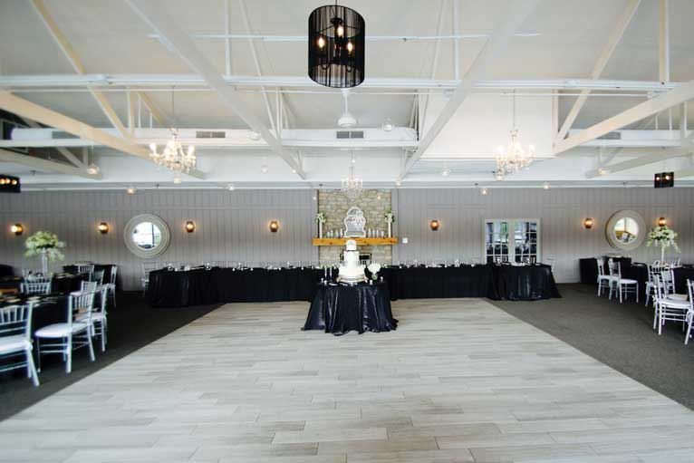 The cake and dance floor at a wedding reception held at The Lodge at The Willows in Indianapolis