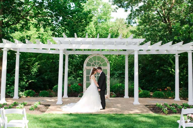 Newlyweds under the pergola at The Lakefront Gardens at The Willows in Indianapolis