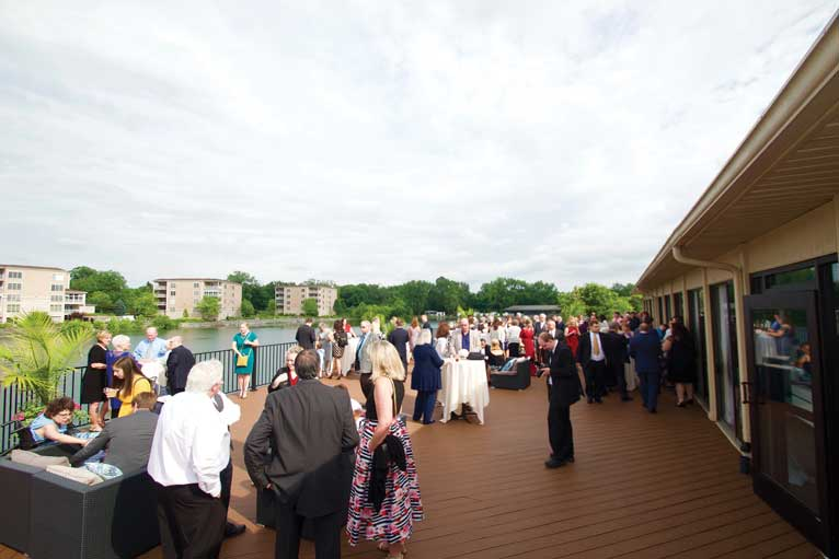 The deck at The Ballroom at The Willows is a lakefront and outdoor venue that wedding receptions guests love