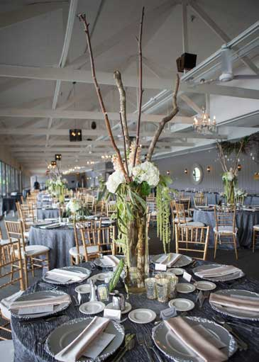 Flower and Stick Centerpieces for a contemporary wedding reception at The Lodge at The Willows
