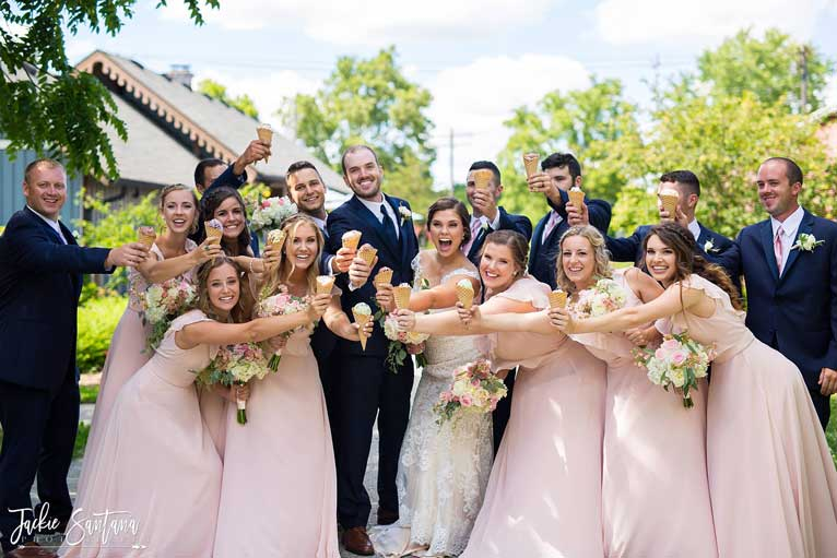 Bridal party poses with ice cream cones for a summer wedding - a great wedding photography idea (The Ballroom at The Willows)