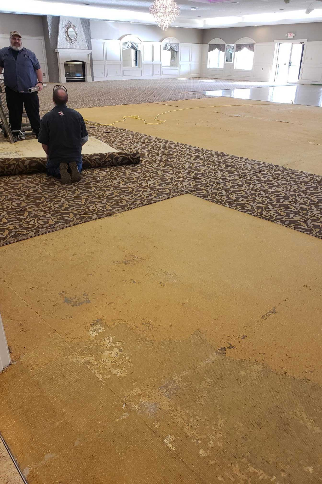 Ripping up the old patterned carpet in the The Ballroom at The Willows