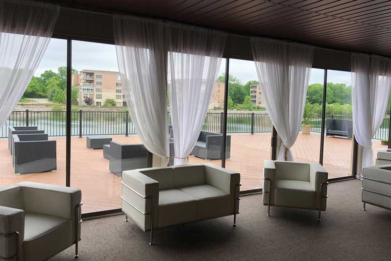 The terrace and deck of The Ballroom at The Willows offer guests lakefront views and outdoor seating
