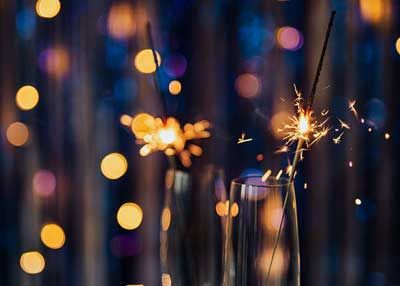 Sparklers in champagne flutes on New Year's Eve