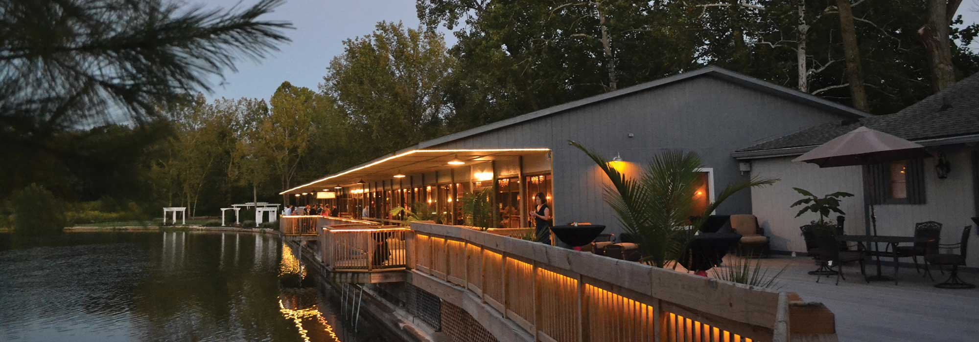 The lakefront event, The Lodge at The Willows, is a unique evening event venue