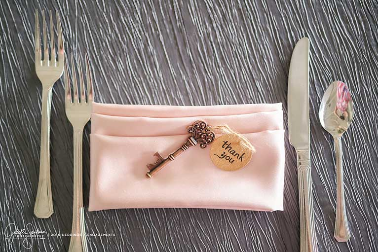 Garden-themed place setting for a wedding reception at The Lodge at The Willows