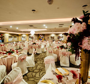 The Ballroom at The Willows decorated in pink for a formal wedding reception in Indiana