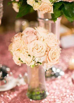 Shorter centerpieces paired with taller centerpieces make a statement at this wedding reception at The Willows Event Center