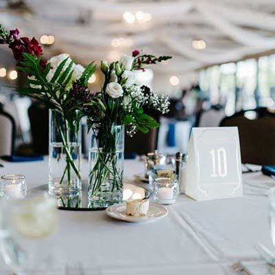 Short centerpiece with a pop of color at a wedding reception at The Lodge at The Willows