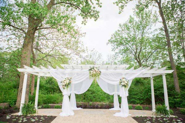 Airy drapes on the pergola for a wedding ceremony at The Lakefront Garden at The Willows in Indianapolis