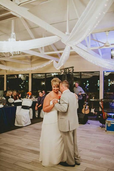 Bride and Groom's first dance during their wedding ceremony at The Lodge at The Willows