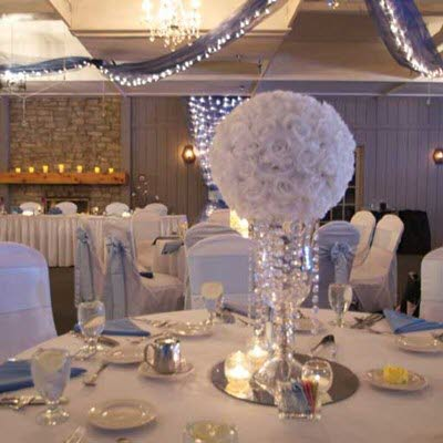 Round centerpieces at a white wedding at The Lodge at The Willows