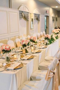 Family-style seating arrangement for an elegant wedding reception in The Ballroom at The Willows