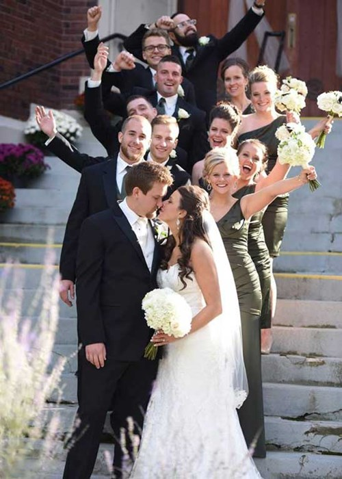 Bridal party poses on the steps of the Indianapolis wedding ceremony venue