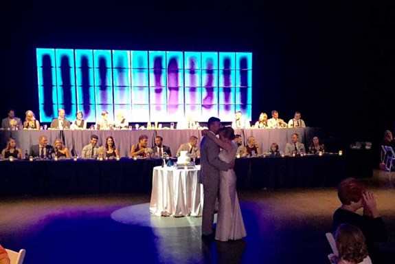 Two-tiered head table for a wedding reception (The Crane Bay Event Center)