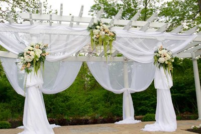 The pergola at The Lakefront Garden at The Willows decorated for an Indiana spring wedding ceremony
