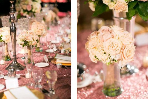 Romantic wedding themed decorations sit on a table at a reception at The Lodge at The Willows