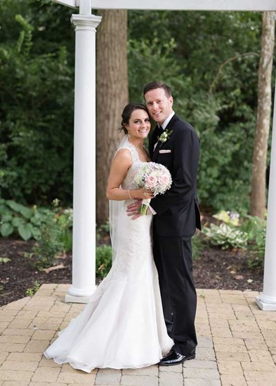Bride and Groom at The Lakefront Gardens at the Willows under the pergola of this outdoor venue in Indianapolis