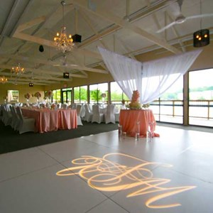 Lovely lighted monogram on the dance floor of The Lodge at The Willows in Indianapolis