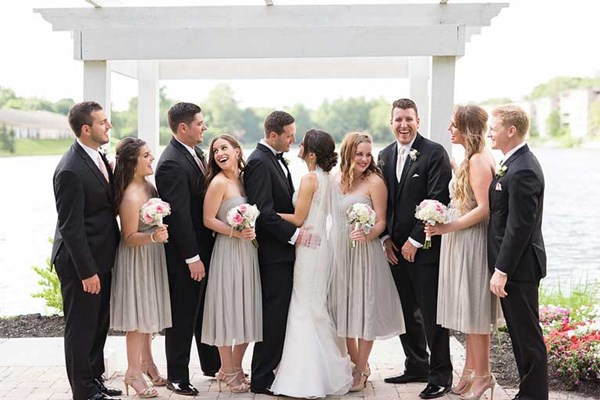 Bridal party in front of Spirit Lake at The Willows Event Center