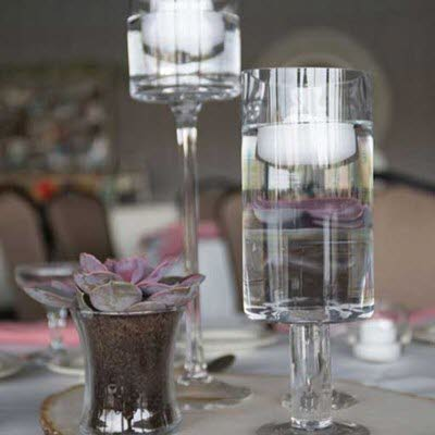 Floating candle centerpiece for a wedding reception at The Lodge at The Willows