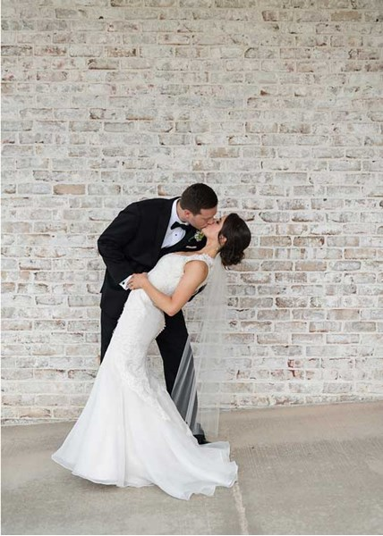 Groom dips the bride in this perfect wedding photo at The Lodge at The Willows