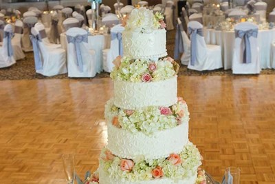 A four-tiered cake for a contemporary wedding reception at The Ballroom at The Willows