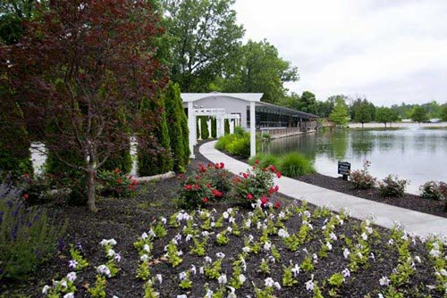 The path along Spirit Lake at The Lakefront Gardens makes the perfect reveal for a bride in Indianapolis
