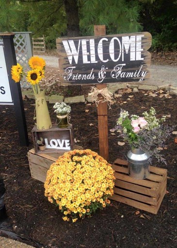 Wooden signs give weddings a rustic feel