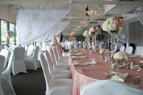 A romantic inspired wedding reception features sheer drapes at The Lodge at The Willows