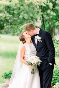 Travis and Kathleen kissing after their wedding ceremony in Broad Ripple at St. Pius