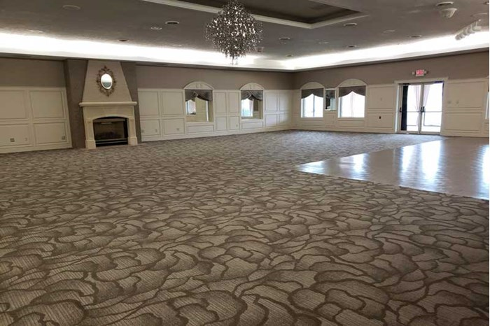 The Ballroom at The Willows with new carpet is ready to host a wedding or corporate event