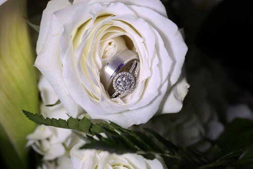 Wedding rings in the center of a flower at The Ballroom at The Willows in Indianapolis
