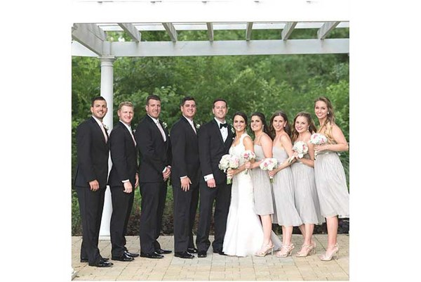 Bridal party poses under pergola of The Lakefront Garden at The Willows in Indianapolis