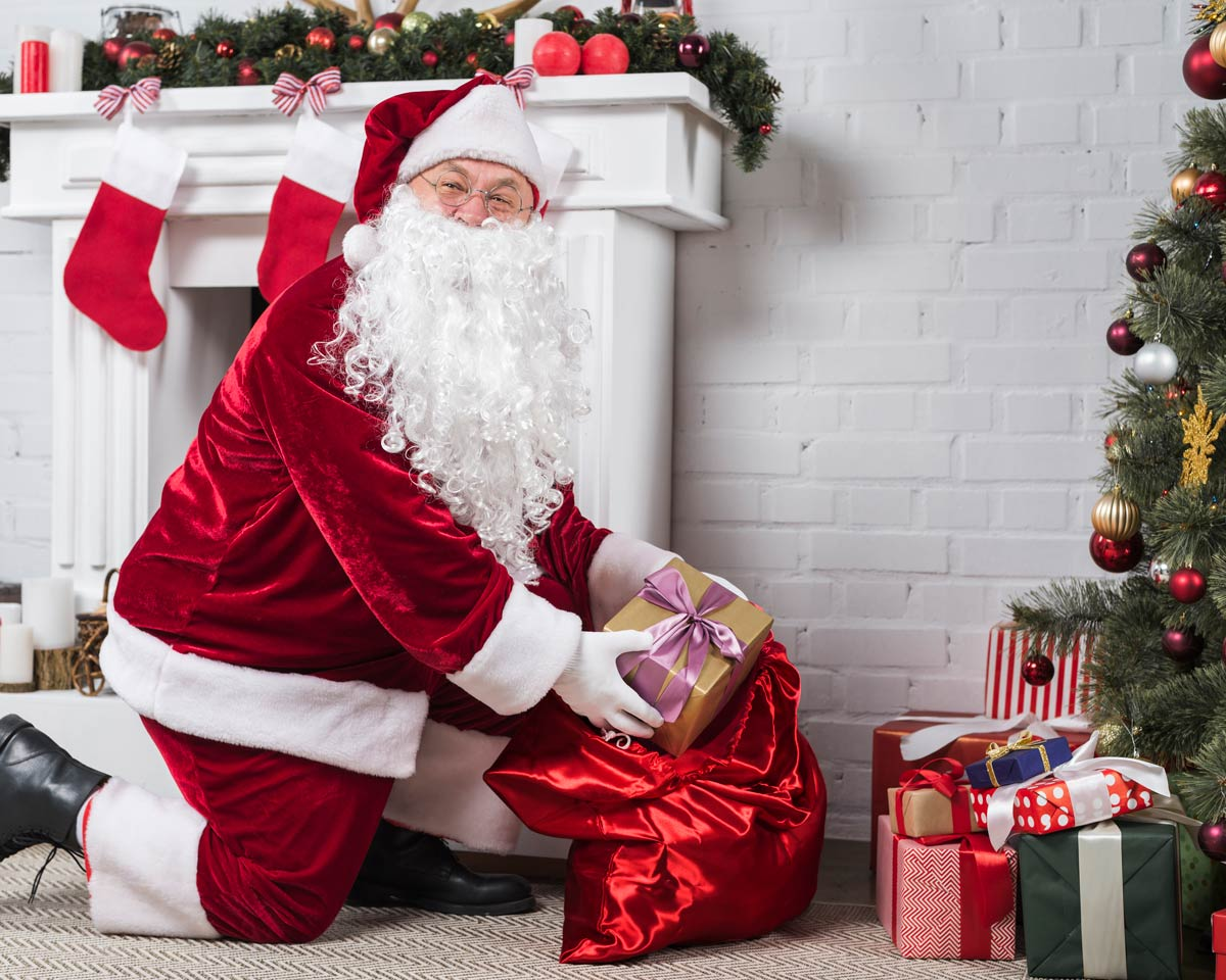 Santa kneeling on carpet putting Christmas gifts under the tree <a href='https://www.freepik.com/photos/christmas'>Christmas photo created by freepik - www.freepik.com</a>