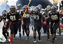 Football Athletes Running on Field