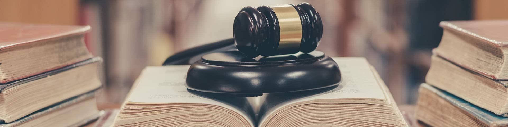 Gavel and block on a workers compensation law book